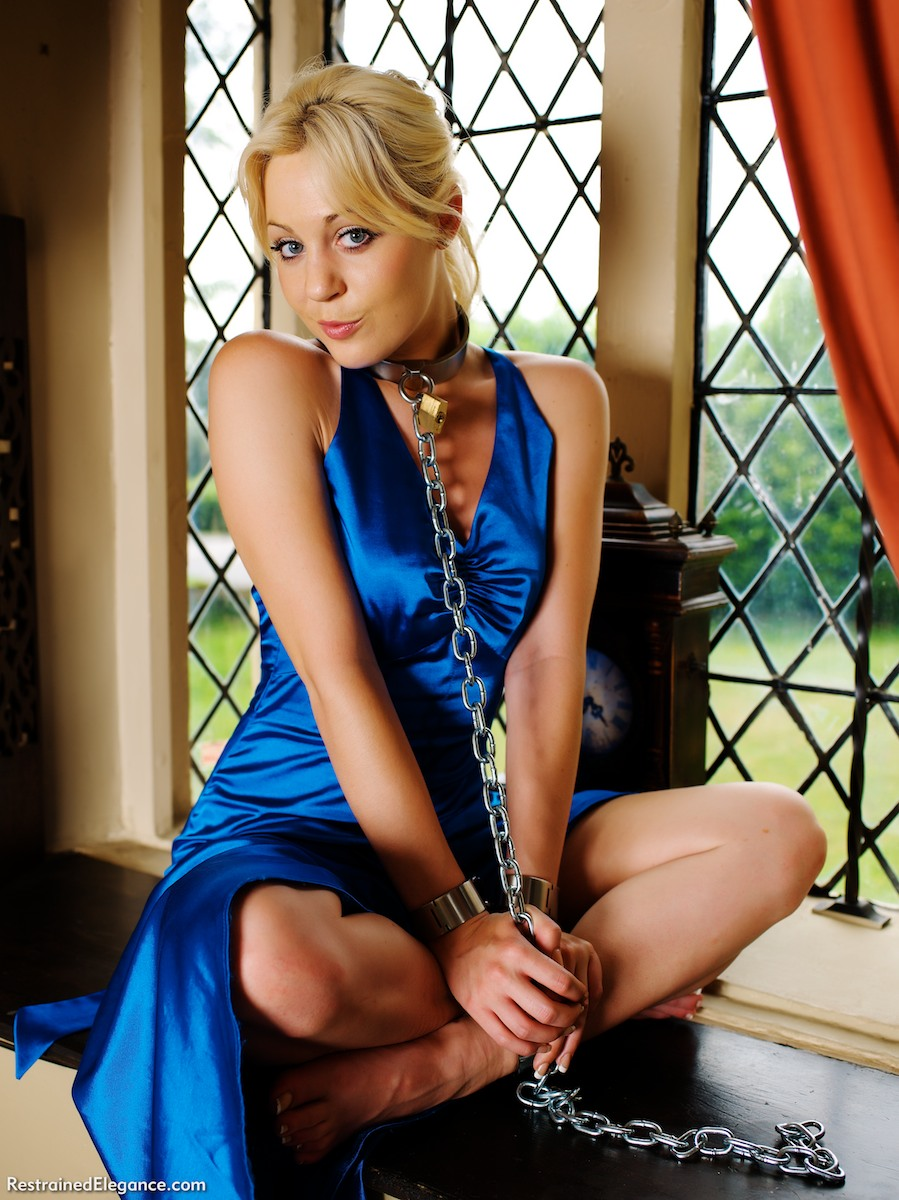 Paige Robbins clapped in irons- collared and chained in her blue satin gown